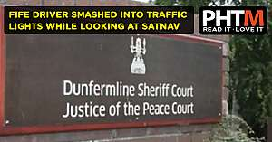 FIFE DRIVER SMASHED INTO TRAFFIC LIGHTS WHILE LOOKING AT SATNAV