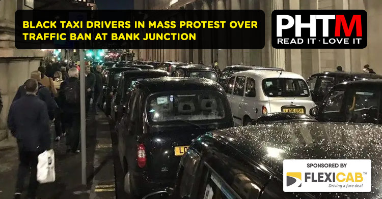BLACK TAXI DRIVERS IN MASS PROTEST OVER TRAFFIC BAN AT BANK JUNCTION