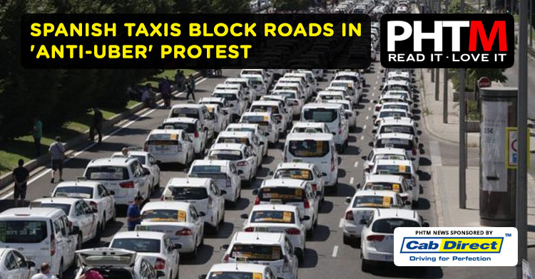 SPANISH TAXIS BLOCK ROADS IN 'ANTI-UBER' PROTEST