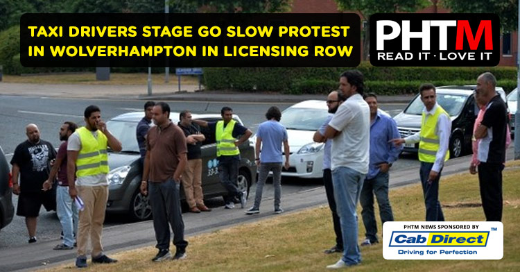 TAXI DRIVERS STAGE GO SLOW PROTEST IN WOLVERHAMPTON IN LICENSING ROW