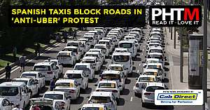 SPANISH TAXIS BLOCK ROADS IN ANTI UBER PROTEST