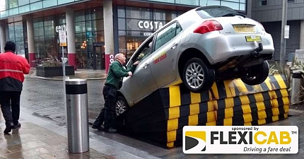 TAXI GETS STUCK AT 45 DEGREE ANGLE ON RAMP AT MEDIA CITY