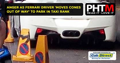 ANGER AS FERRARI DRIVER MOVES CONES OUT OF WAY TO PARK IN TAXI RANK
