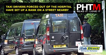 TAXI DRIVERS FORCED OUT OF THE UNIVERSITY HOSPITAL HAVE SET UP A RANK ON A STREET NEARBY